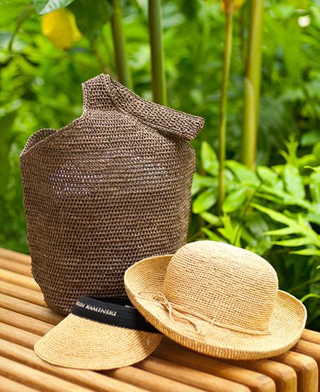 Helen Kaminsky weave visor, hat, and brown weave shoulder bag at Accents, Moana Surfrider