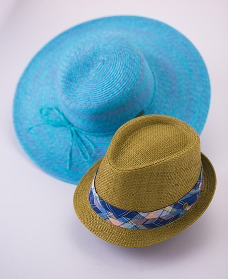 two weave hats by Chapel Hats, one blue wide brim, and one brown bowler