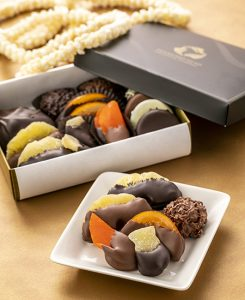 assortment of hand-dipped chocolates from DHCC in a box and on a plate