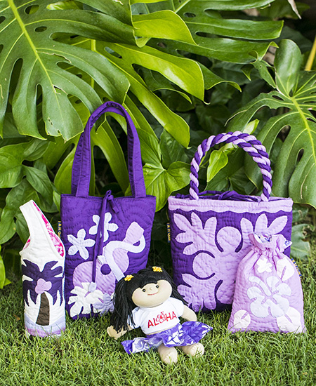 hawaiian quilt handbags, wine carriers, and satchels (4 total), and a hula skirt stuffed female doll
