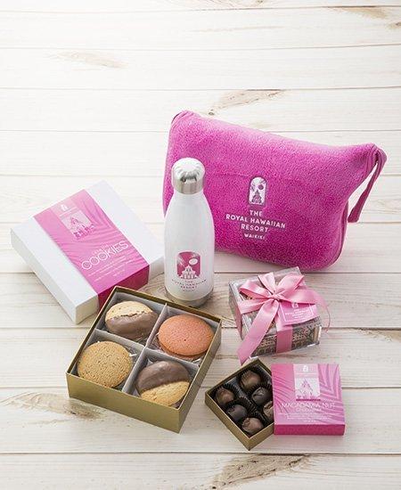 plush pink Royal Hawaiian cosmetic bag, Royal Hawaiian box of cookies and chocolate-dipped macadamia nuts