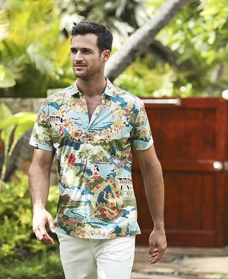 male model wearing a light blue designer hawaiian shirt with palm tree and hula girl imagery