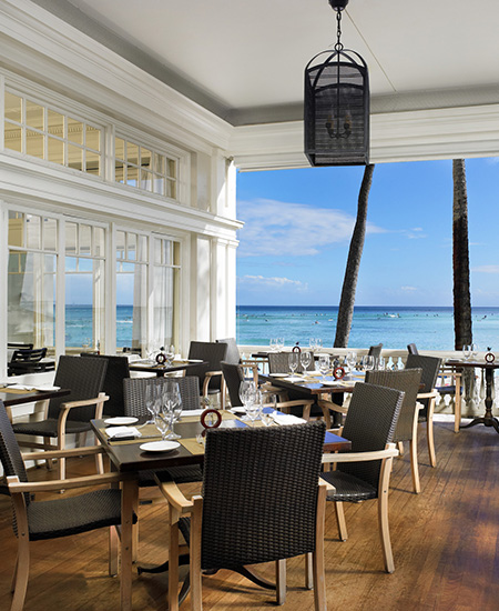 open-air seating at The Veranda overlooking Waikiki Beach