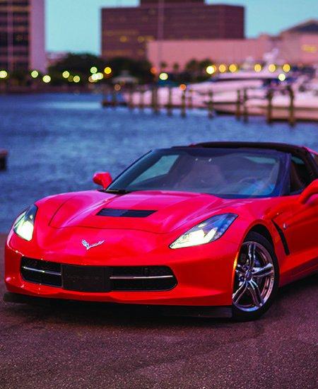 red Corvette car rental from Avis