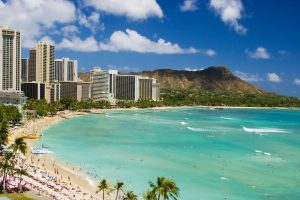the best Waikiki surf spots for beginners! photo of Waikiki beach on a sunny day with Diamond Head in the background