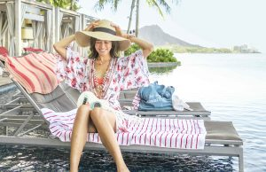 Japanese model Mie sitting at the Sheraton Waikiki Infinity Edge pool with a sun hat on